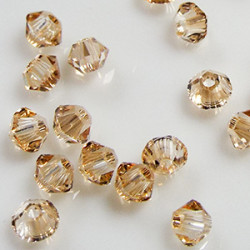 Toupies 3mm Crystal Golden Shadow - réf.5328 Xilion (x20)