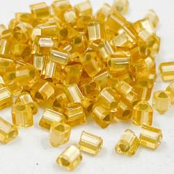 Triangles 11/0 référence 22F Light Topaz Silver Lined Matte (x10)